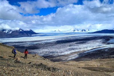 Two hikers look out over the South Patagonian Ice Fields on the Huemul Circuit