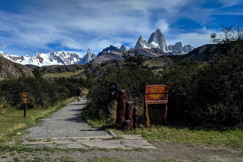 The trailhead for the Huemul Circuit with the Fitz Roy mountain range in the distance