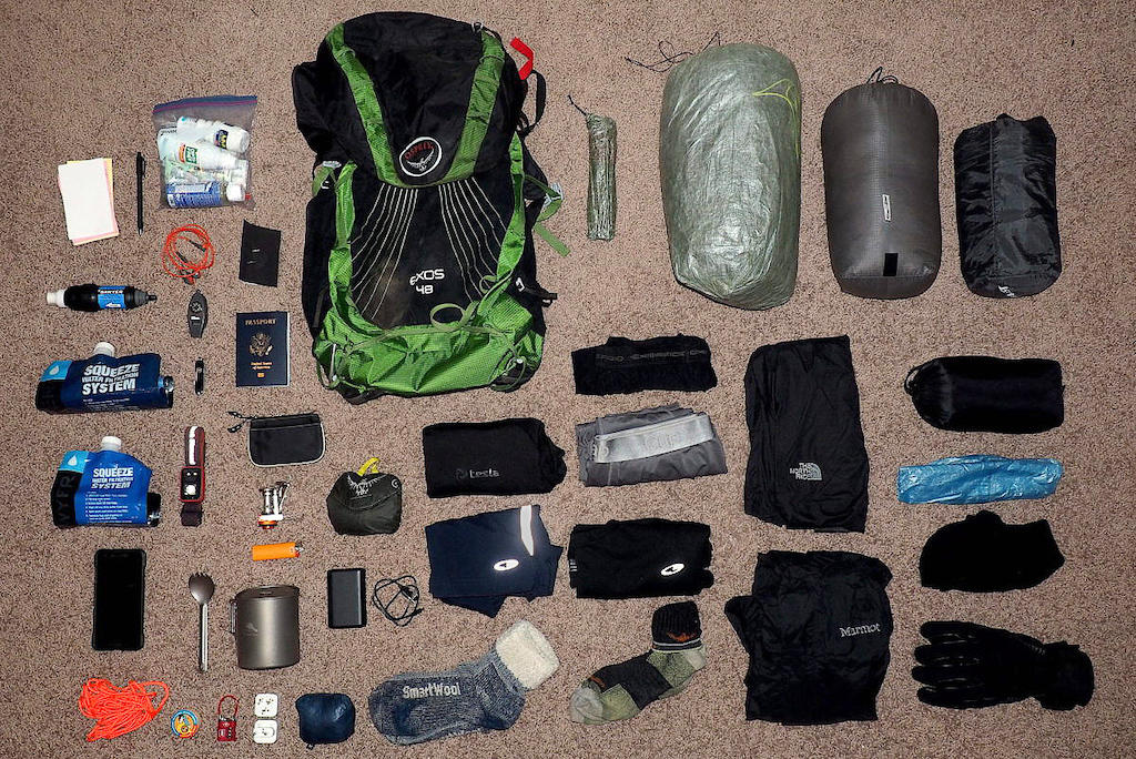 Above view of all my ultralight backpacking gear list laid out across a carpet