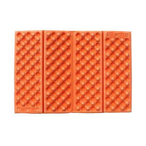 Bright orange ultralight sit pad for hiking and backpacking