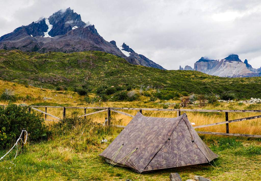 A Zpacks Triplex tent is set up in front of the Cordillera del Paine Mountain Range