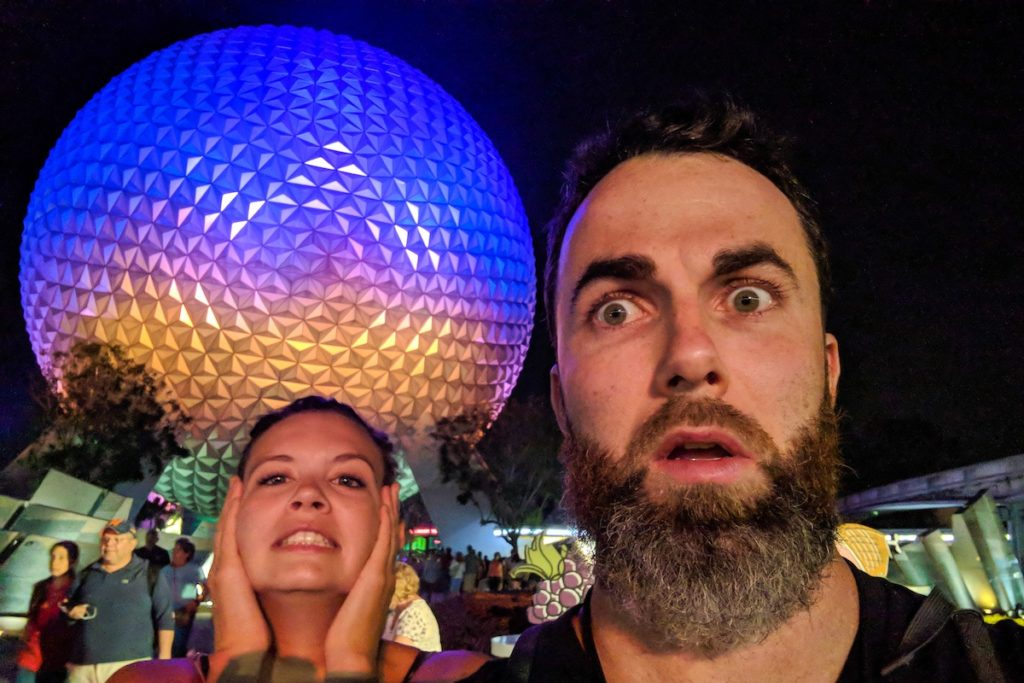 Stressed traveling couple in front of Epcot, Disney