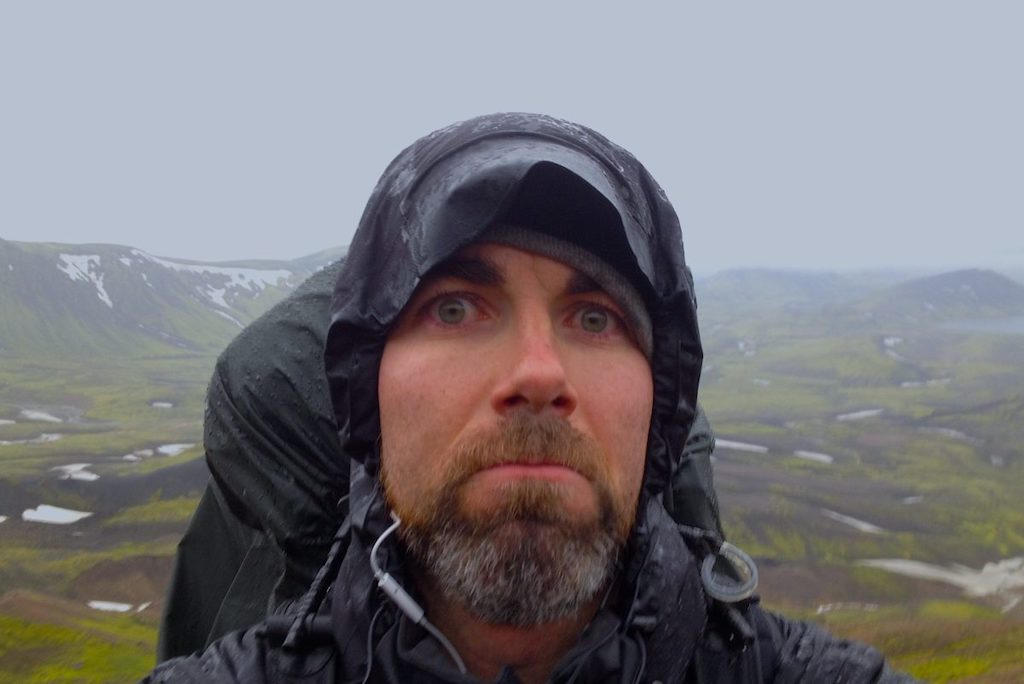A soaking wet hiker selfie on the rainy Laugavegurinn Trail in Iceland
