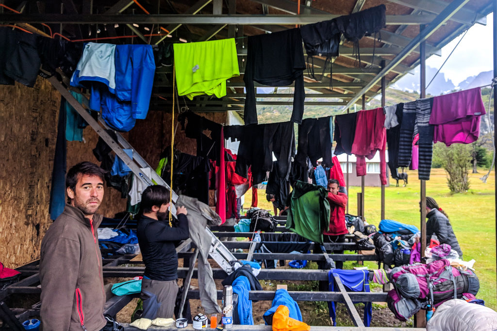 Hikers on the Q trek in Torres del Paine hang their wet clothes in a refugio