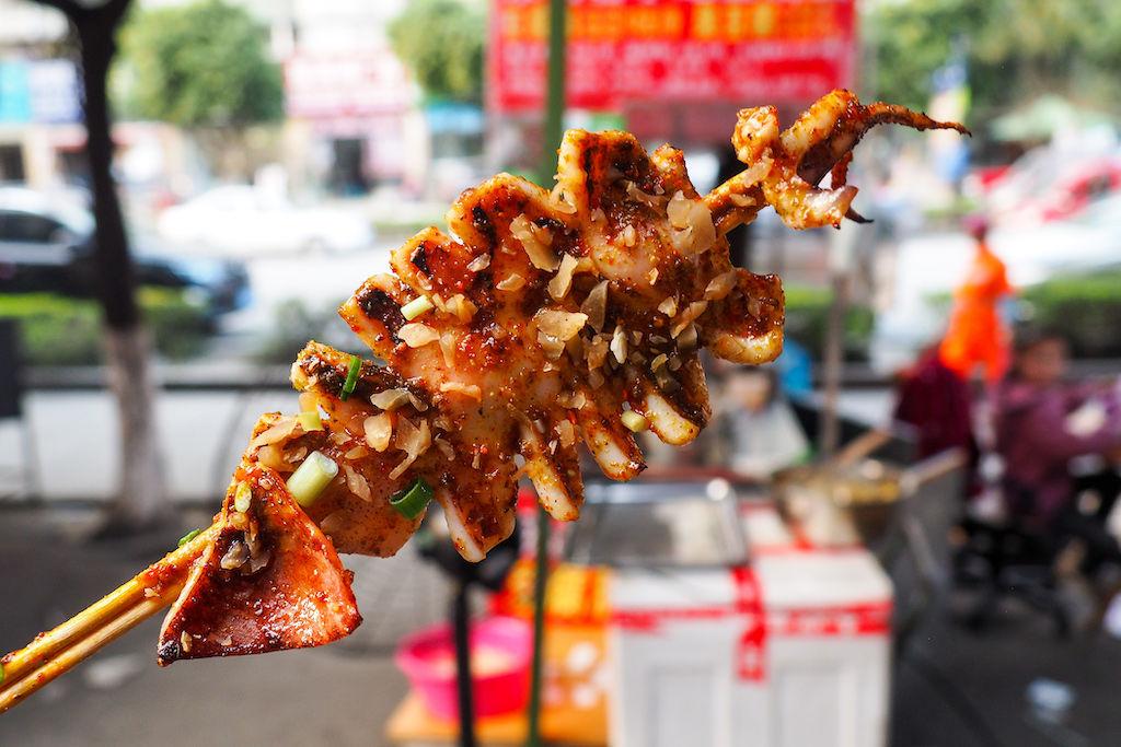 A skewer of generously seasoned grilled squid