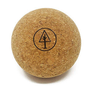A small cork ball with a tree design on it