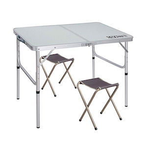 A folding aluminum camping table and chairs