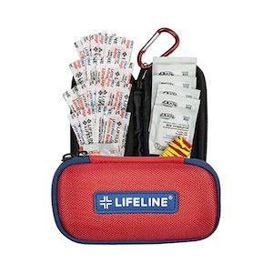 A first-aid kit with supplies fanned out