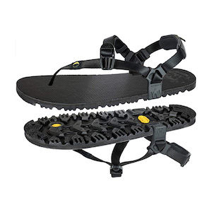 A pair of black minimalist hiking sandals