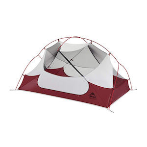 A red and white tent for four-season backpacking