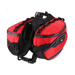 A red saddle bag for hiking with dogs