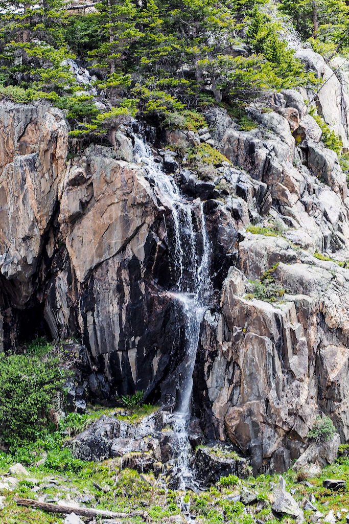 A waterfall down the side of a rugged rock outcropping while hiking in the Gore Mountain Range