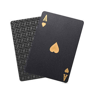 Two black waterproof playing cards