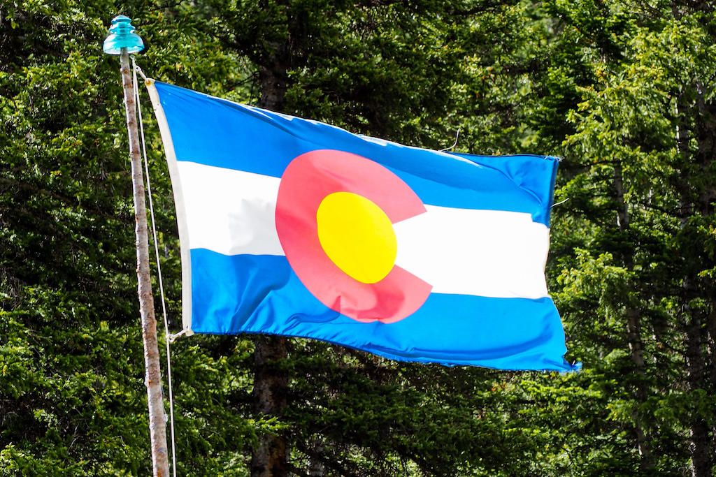 A Colorado flag waving in the wind
