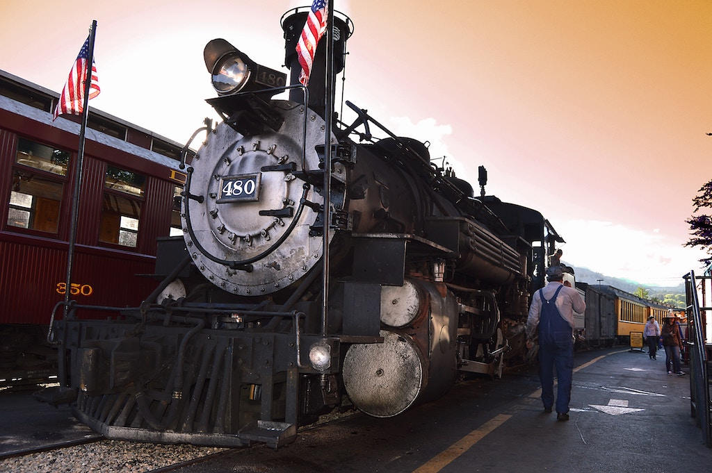 A coal and steam powered train that says '480' on the front