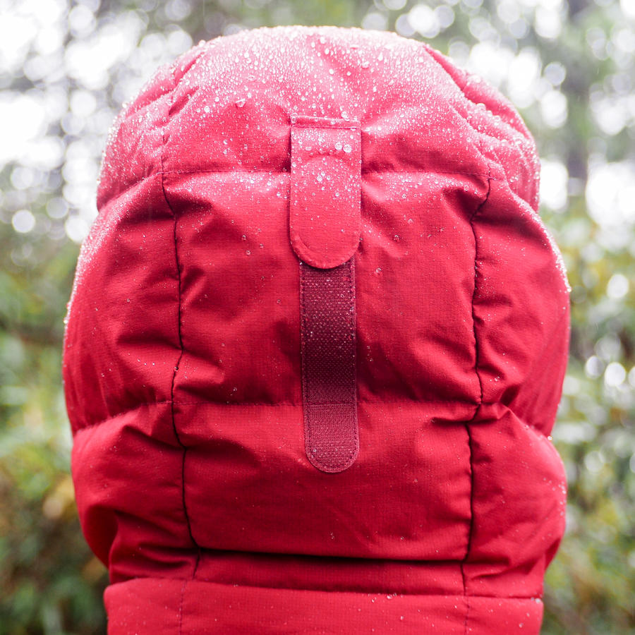Backside view of velcro on the hood of a Montbell brand red down parka