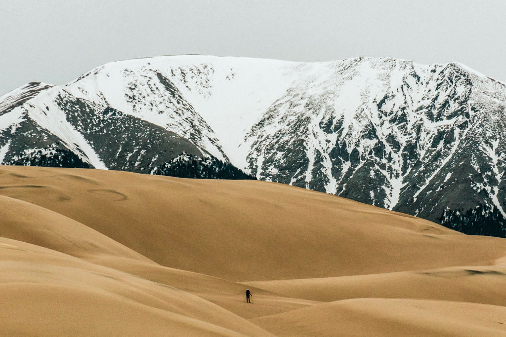 A day hiker on sand dunes in Great Sand Dunes National Park, Colorado
