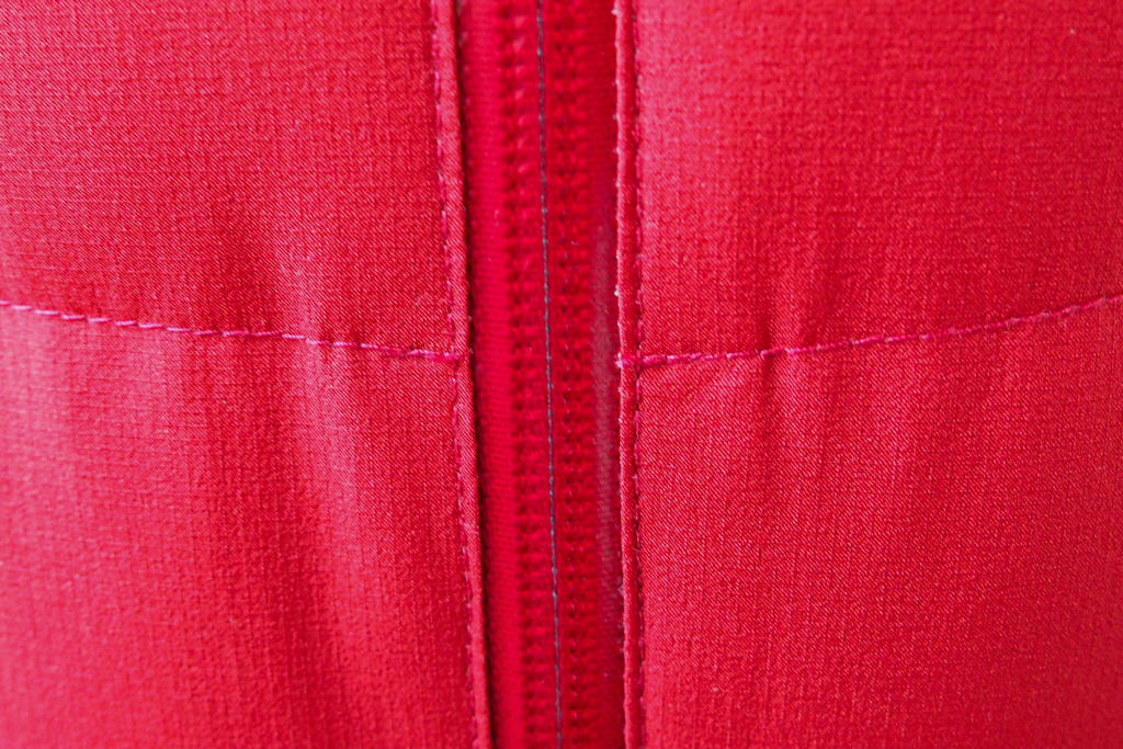 Up close view of seams and zipper of a Montbell lightweight down parka