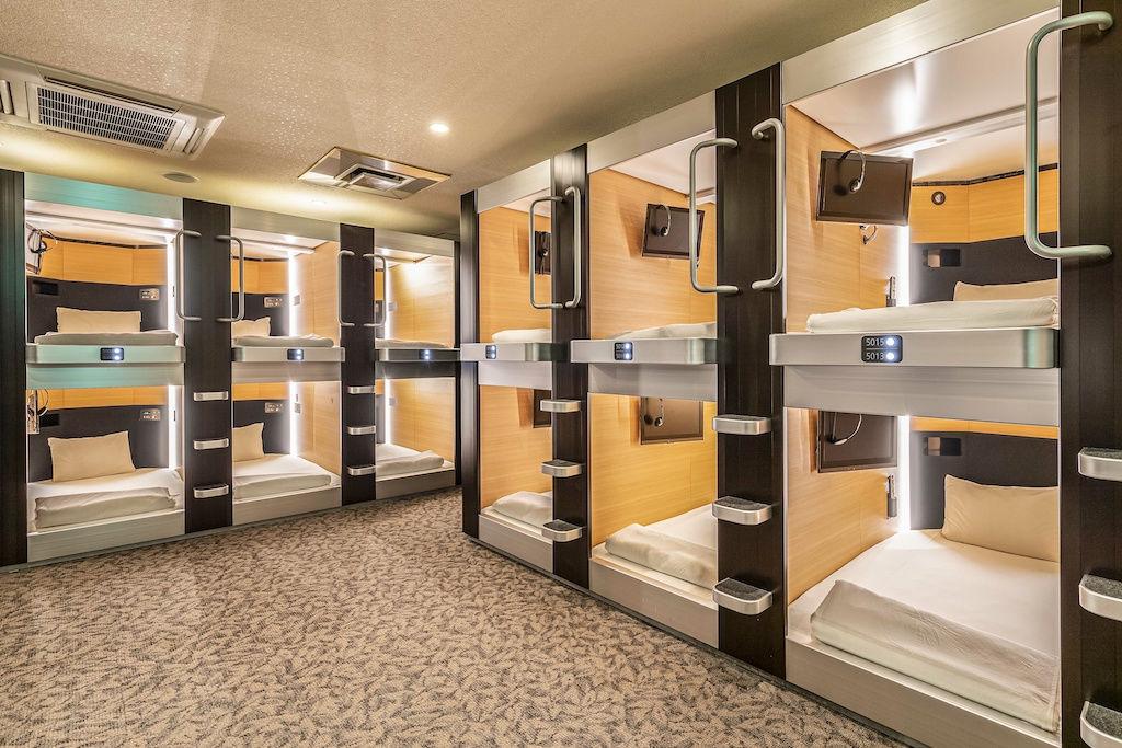Hostel dorm room with eight to ten capsule beds
