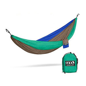 A green and blue hammock for two people
