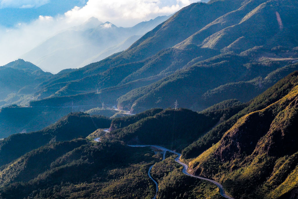 A winding road on a mountain range in Vietnam right before sunset