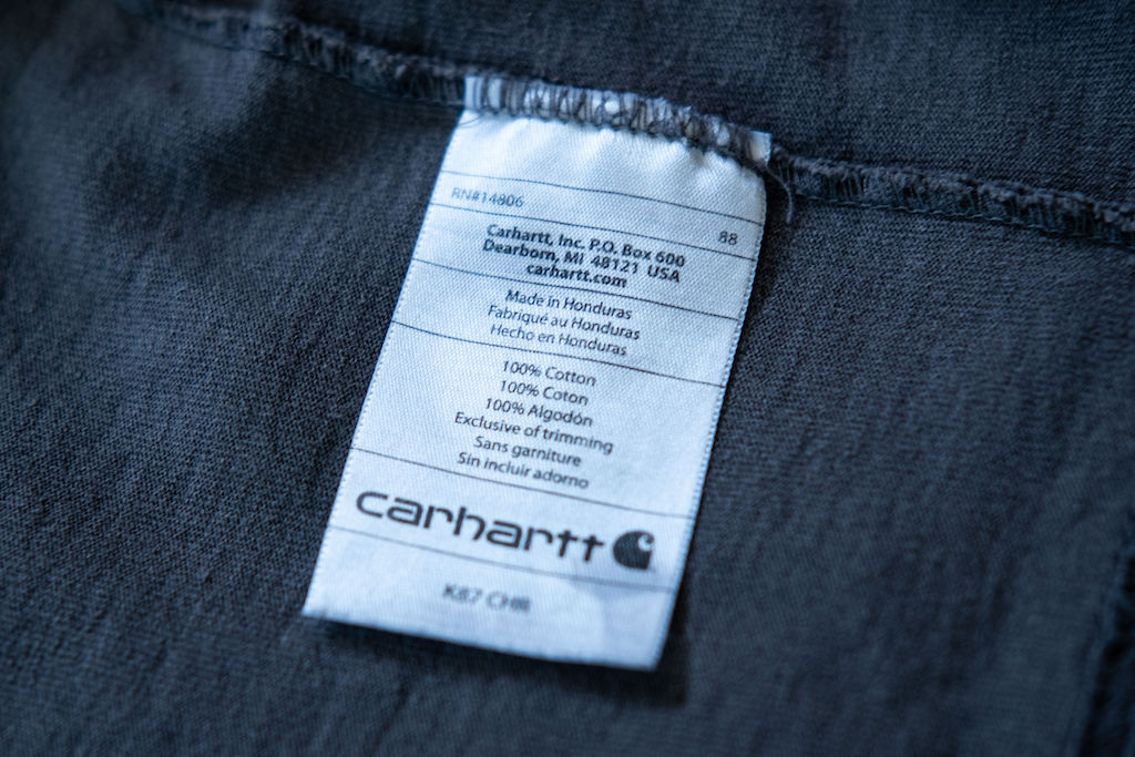 Close-up of grey cotton fabric with a tag