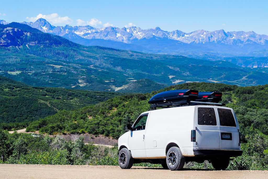 A converted camper van in front of the San Juan Mountains near Ridgway, Colorado