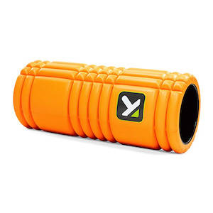 Bright orange foam roller for muscle and joint therapy