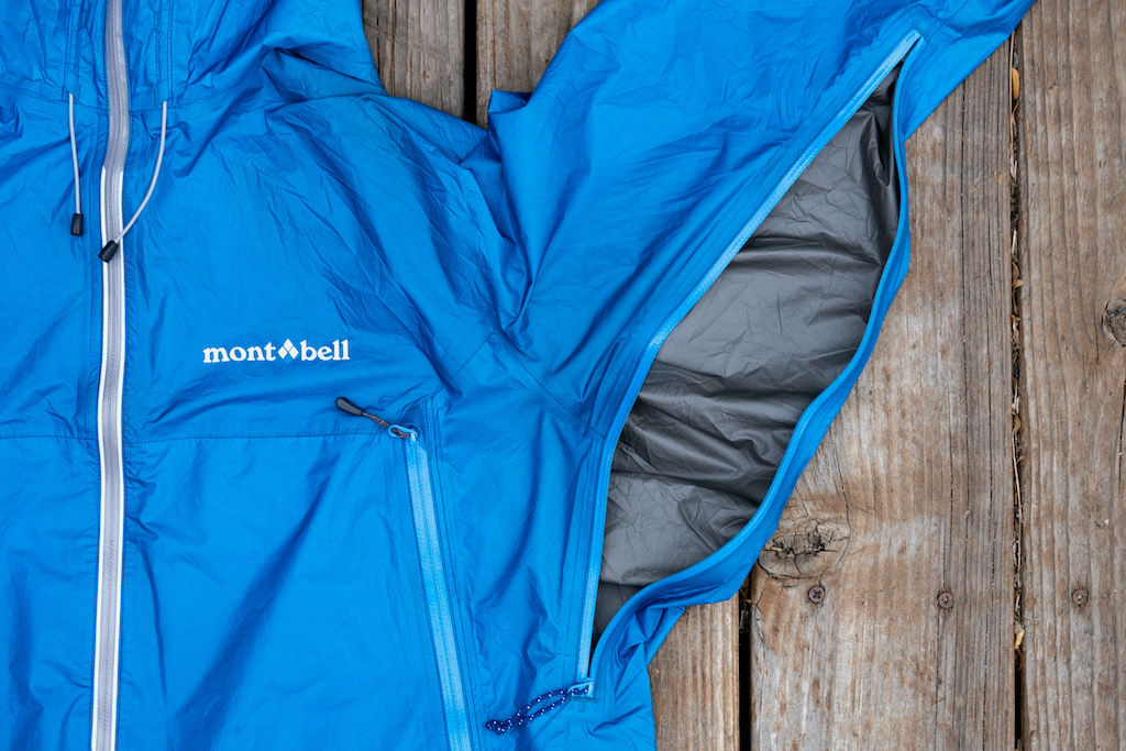 A blue Montbell rain jacket with its pit zip zipped open